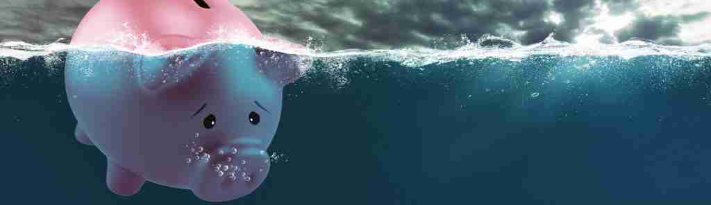 Lonely piggy bank sails in bad waters due to the bank crisis